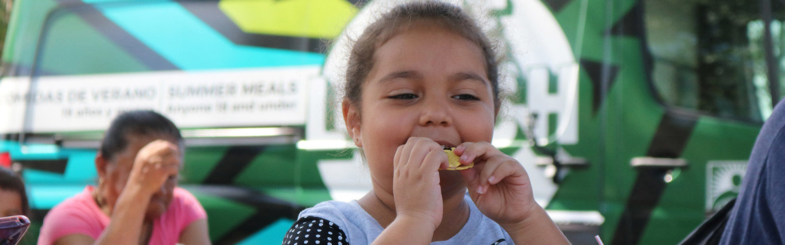 Child eats a lunch at summer meals