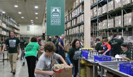 Families volunteer at a repack session