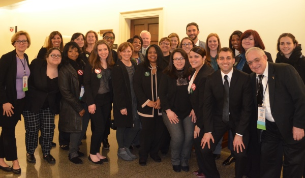 A group of advocates smile after a day at the Capitol