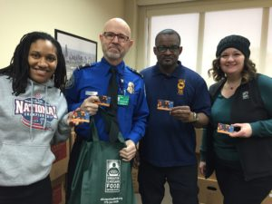 TSA workers hold up their Jewel-Osco gift cards.