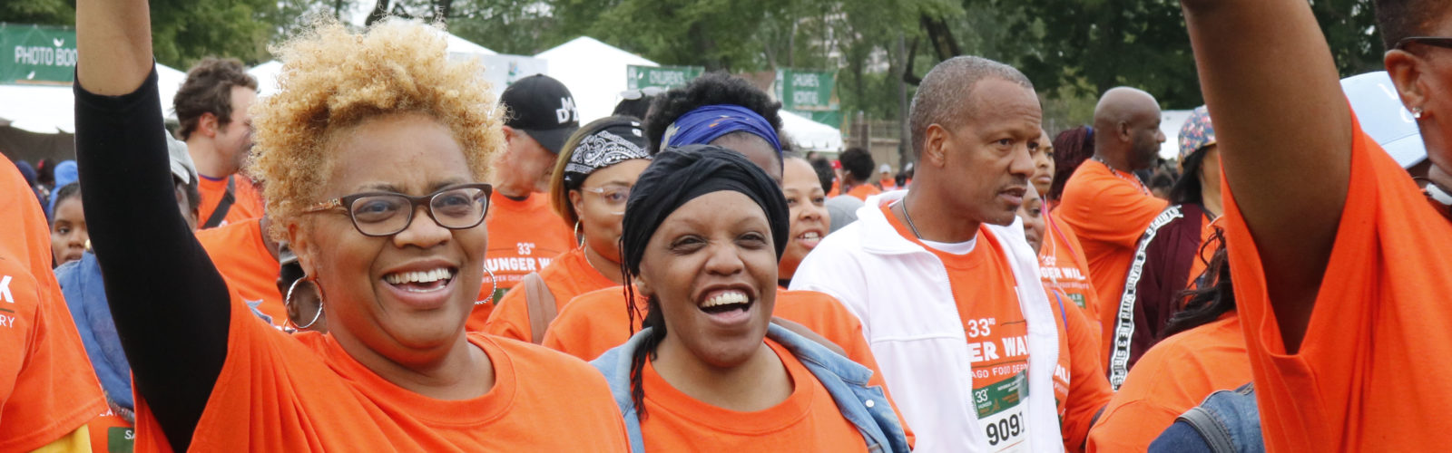 People smiling and cheering at Hunger Walk