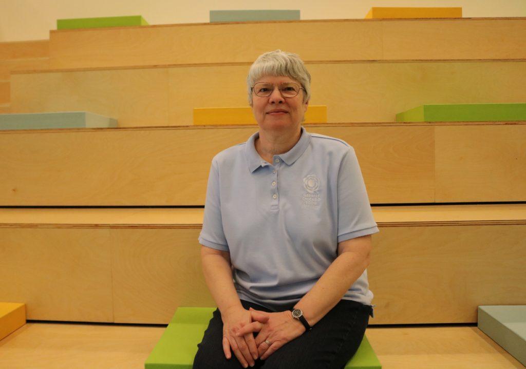 Janet Andersen, the Food Depository's manager of Volunteer Engagement, sits in the new volunteer orientation room.