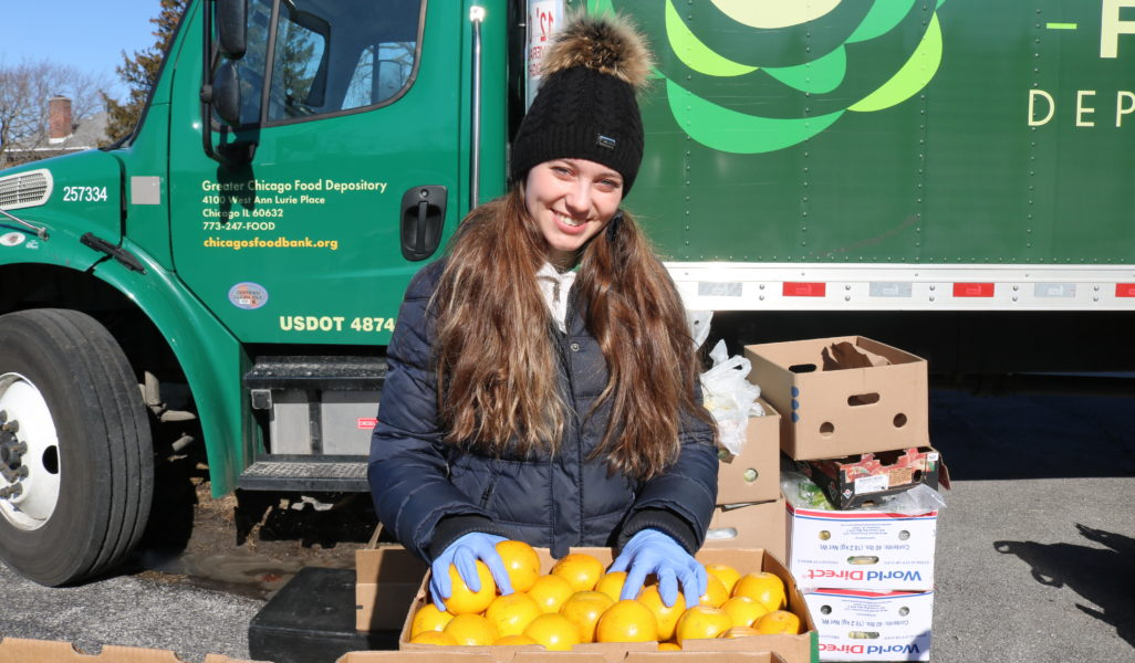 Angelika Kwak, a member of the Hunger Action Corps, at a FRESH Truck distribution in Chicago Heights