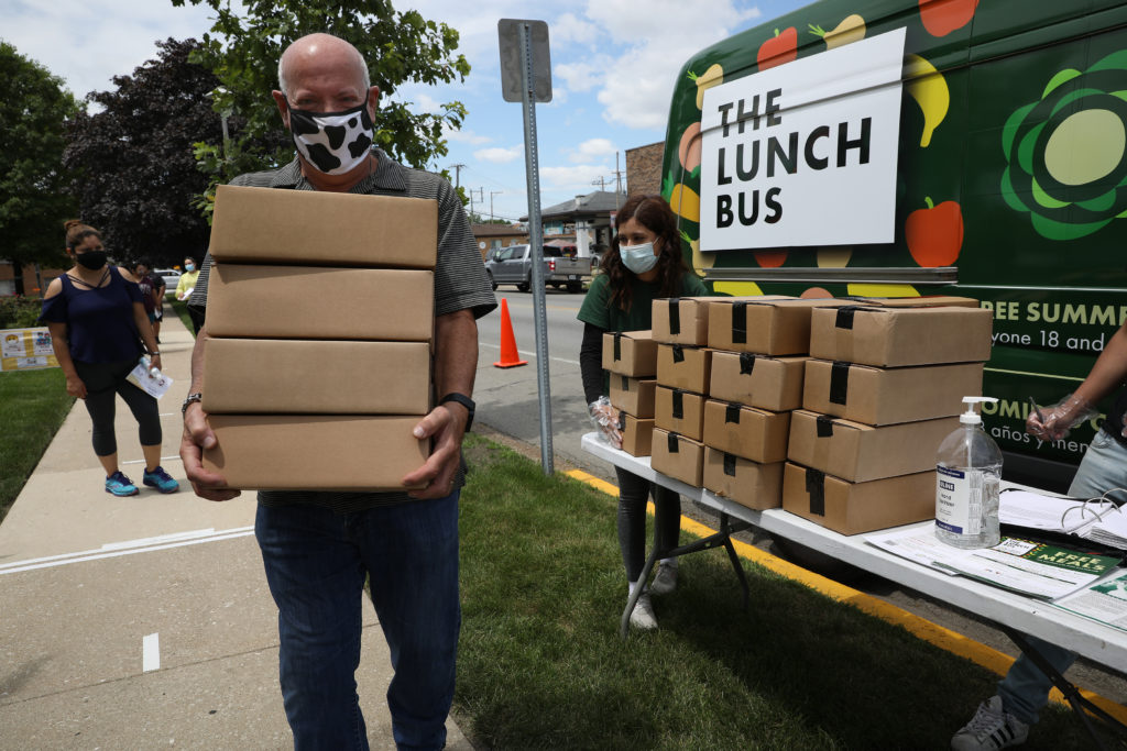 Larry Portnoff picks up meals from the Berwyn Lunch Bus